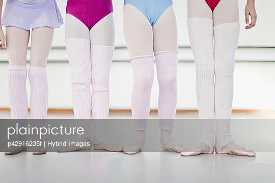 Ballet dancers wearing leg warmers