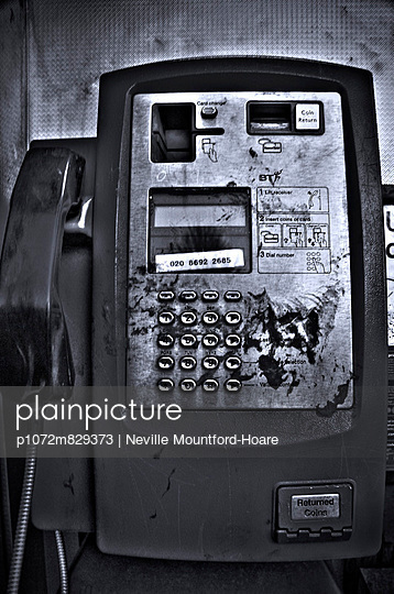 Front of dirty old public telephone