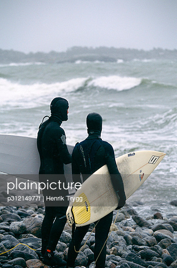 Surfers in stormy weather.