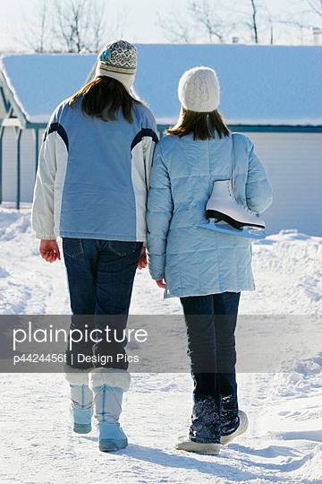 Girls wearing winter clothing