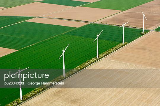 Windmills between fields
