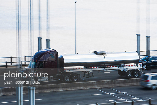 Tanker truck crossing bridge