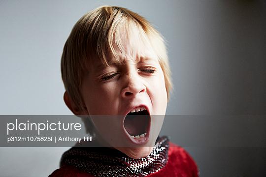 Boy screaming, studio shot