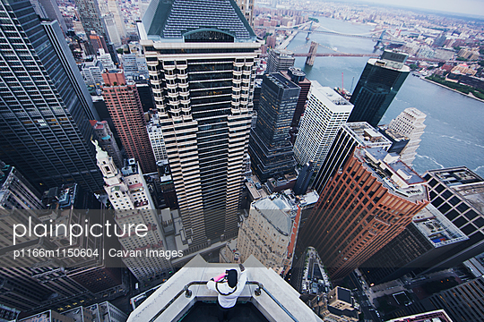 High angle view of man looking at cityscape from observation point