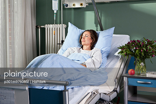 A woman lying in a hospital bed