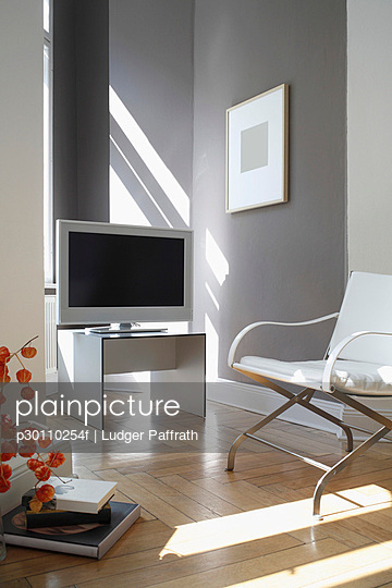 Television and arm chair in a modern living room