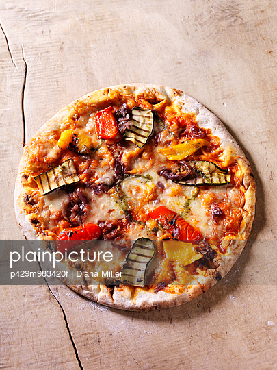 Italian chargrilled pizza with courgettes, peppers, onions, tomatoes and cheese