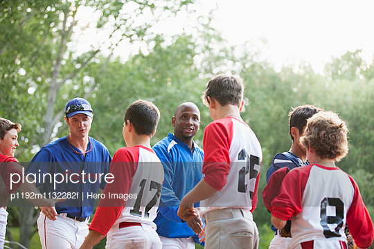 coaches and players shaking hands after ball game