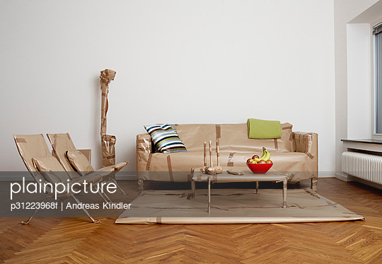 Furniture that has been wrapped up in a living room Sweden