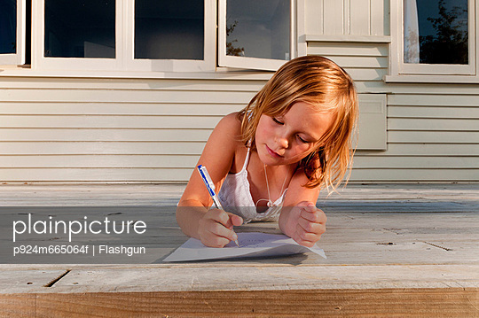 Girl on porch, drawing a picture