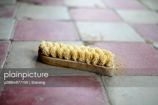 Scrubbing brush on floor
