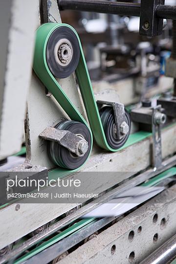 Close up of machine in cardboard factory