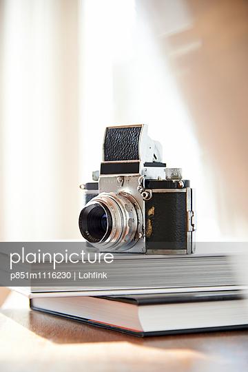 Vintage camera placed on books