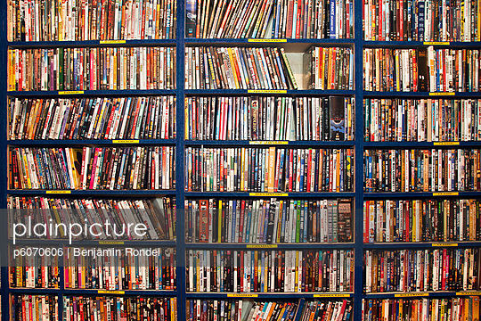 Full frame of rows of DVDs in video store or library