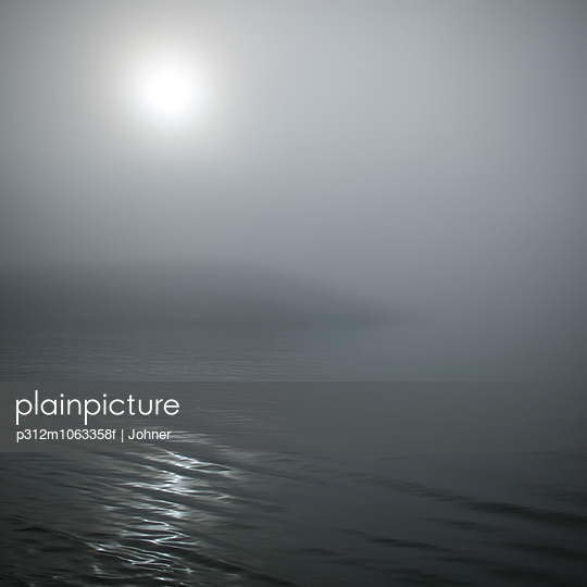Sea and coast at foggy night