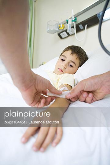 Boy lying in hospital bed