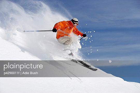 Austria, Saalbach, male skier jumping on slope