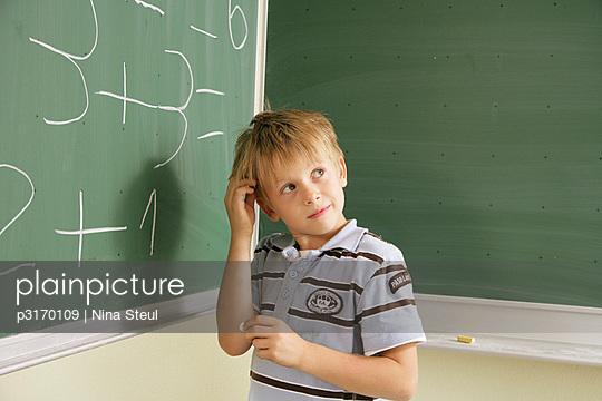 Little boy in school