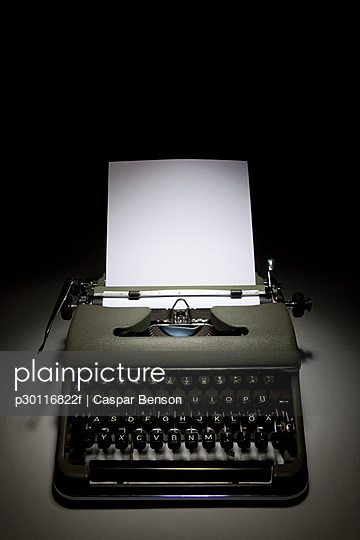 An old-fashioned typewriter with paper