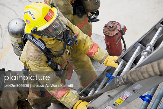 Firefighter Preparing To Climb Ladder At Fire Site, Spokane, Washington