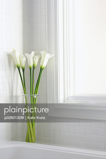White calla lilies in a white bathroom