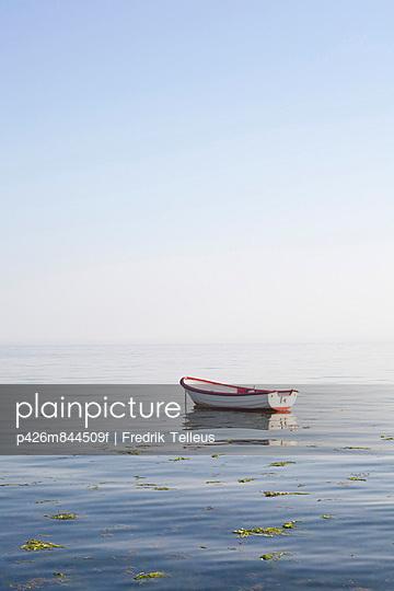 Rowboat moored at open sea