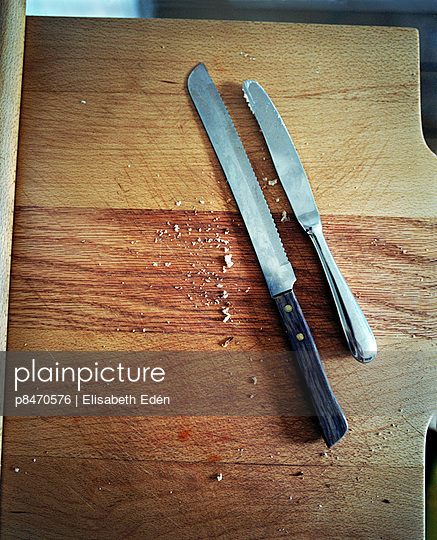 Knifes On Wooden Table