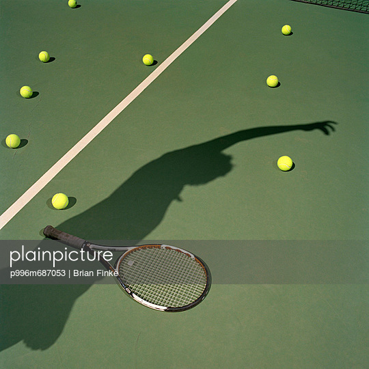 Shadow Of Tennis Player On Tennis Court