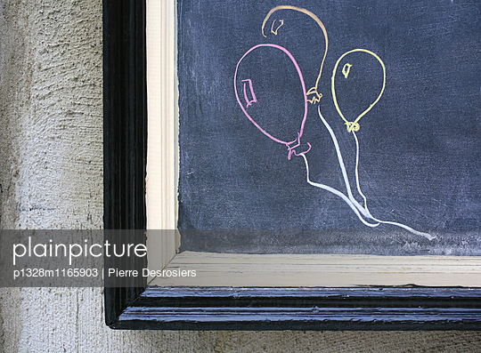 Balloons drawn on chalkboard.