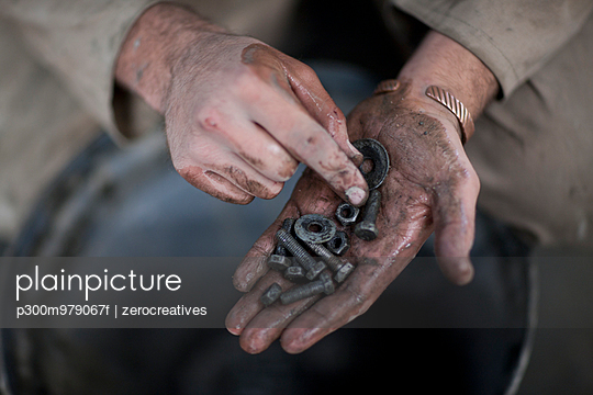 South Africa, Craftman holding screws