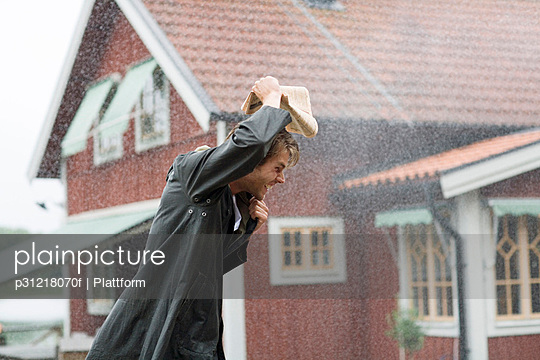 A man outdoors in the rain Sweden.