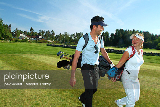 Woman and man on the golf course