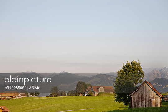 Rural scene with mountain range in background