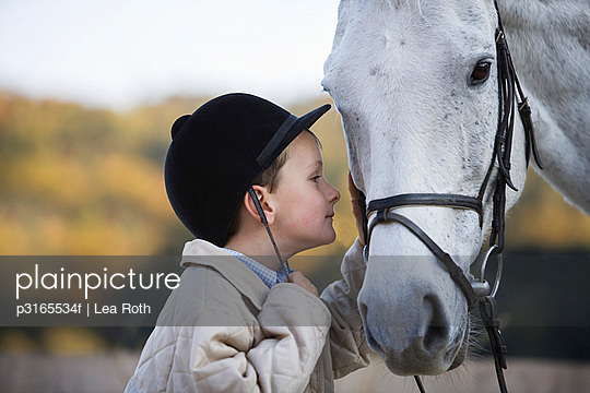 young boy and white horse