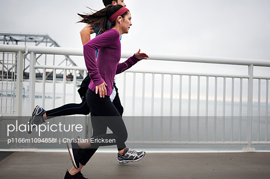 Side view of determined athletes running on Bay Bridge