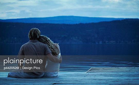 Couple sitting on dock