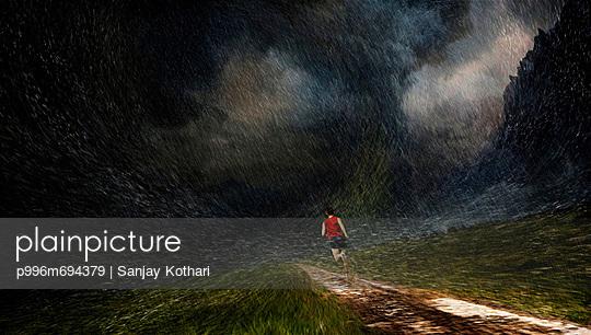 Man Running Through A Rainy Landscape.