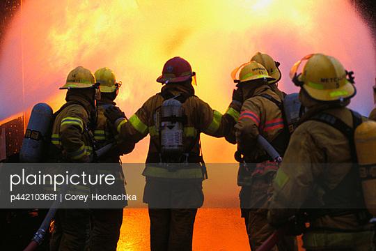Firemen In Front Of Fire