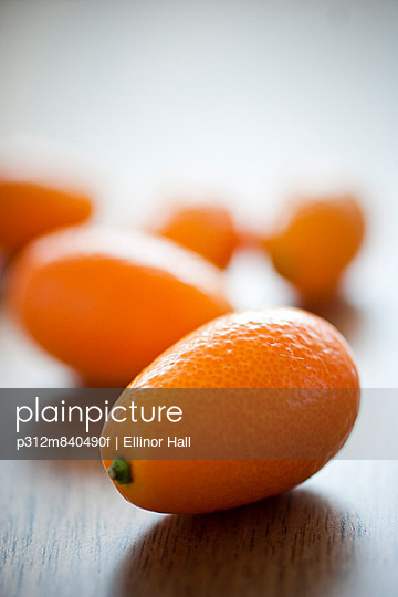 Kumquat fruits on wooden table