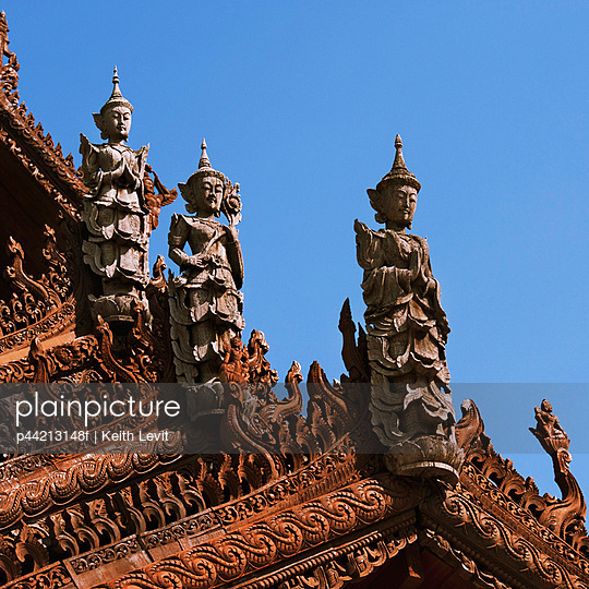sculptures on the roof of mandarin oriental hotel; chiang mai, thailand