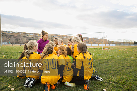 Soccer players and team planning strategy on field