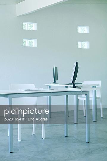 Desktop computers on desks in office