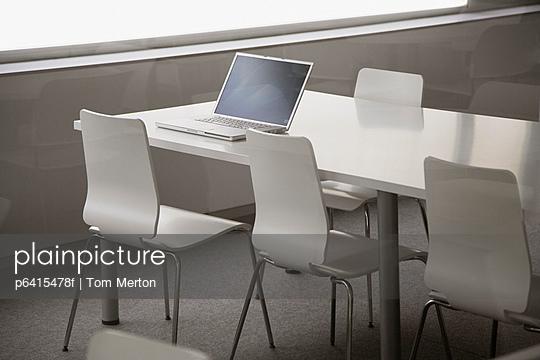 Laptop in empty corporate training room