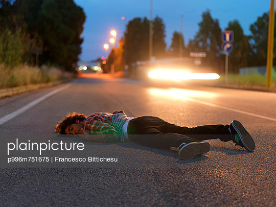 Man Sleeping In Middle Of Road