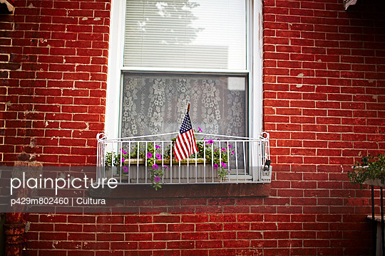 Window and red brick wall