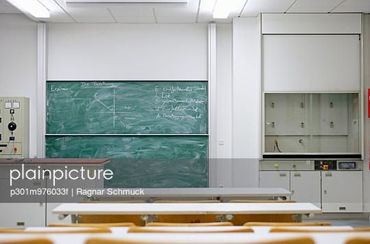 A physics diagram on a blackboard
