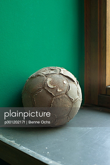 Worn out soccer ball on ledge