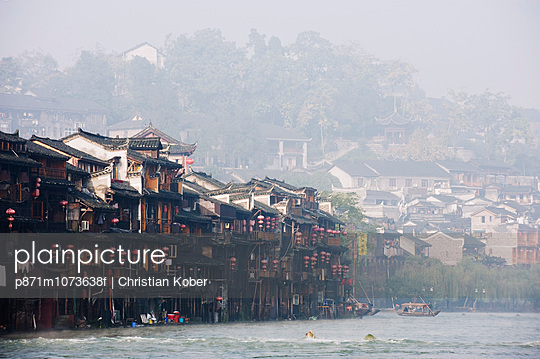Wooden stilt houses in riverside old town of Fenghuang, Hunan Province, China, Asia