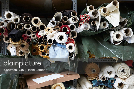 Rolls of fabric in textiles factory