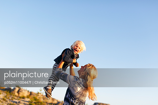 Sweden, Gotland, Faro, Mother playing with little son (2-3)